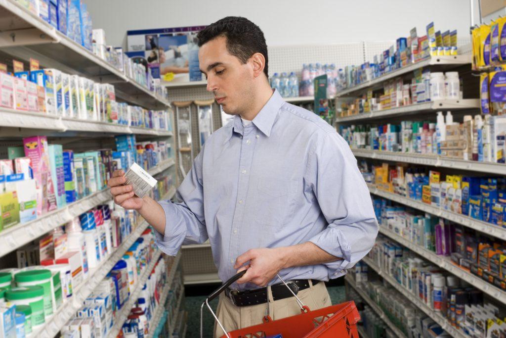 Customer looking at medication box
