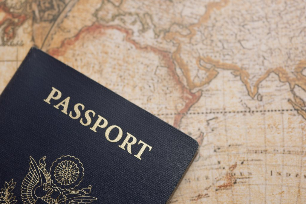 USA Passport on World Map with Copy Space