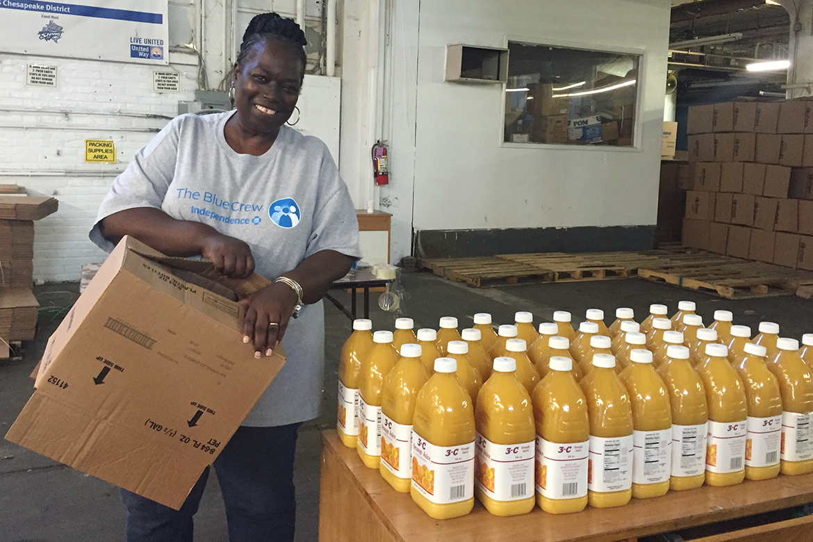 Blue Crew Volunteer Kim Carter-James giving back to the community.