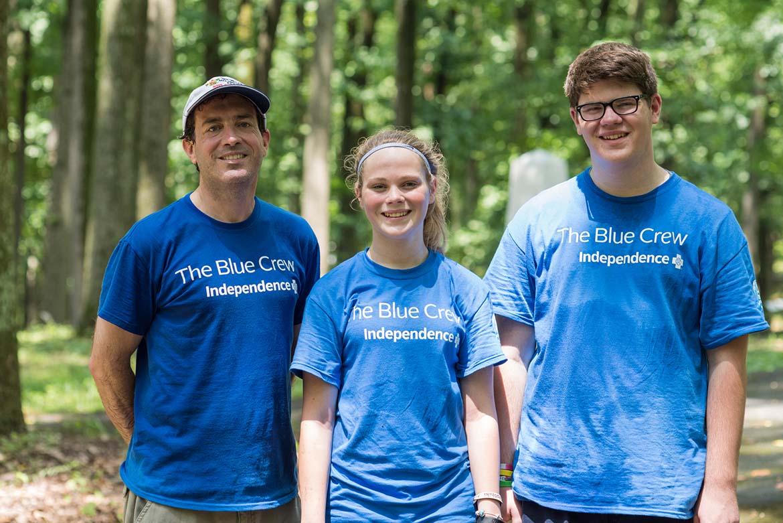 Blue Crew volunteer Matthew White pictured with his children after volunteering.