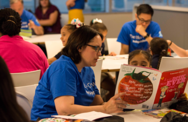 Blue Crew volunteers are raising readers as tutors, mentors, and friends to first graders participating in the Philadelphia Reads Power Partners program.