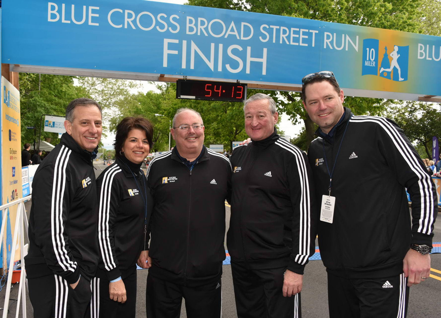 Race Director Jim Marino (center) at the finish line of the 2017 Blue Cross Broad Street Run with (left to right): IBX SVP of Public Affairs Stephen Fera, IBX Corporate Relations Executive Kathy Albanese, Philadelphia Mayor Jim Kenney, and IBX President &SVP of Commercial &Consumer Markets Brian Lobley.