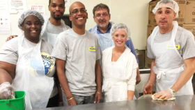 Volunteer time is family time for Denise Green and her son, Dwayne, who join the IBX Blue Crew at MANNA to prepare meals for people struggling with illness.