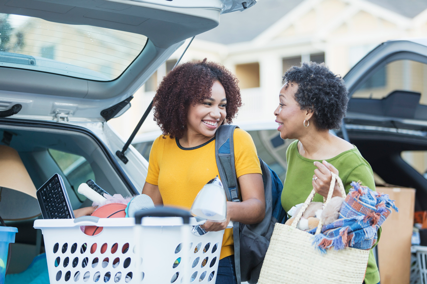 A mother helps her college-bound daughter load the car