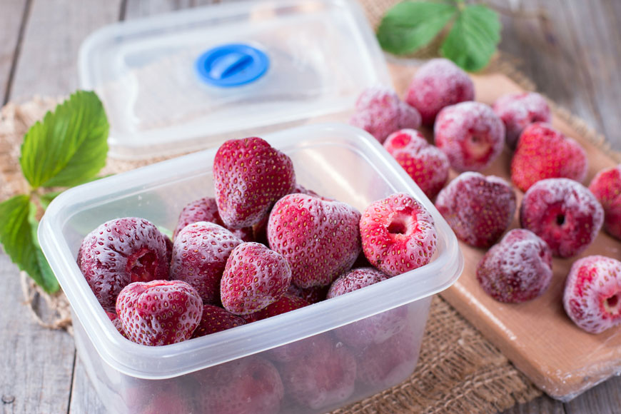 A container of frozen strawberries