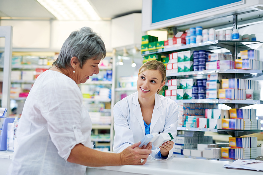 Senior talking to pharmacist about generic prescription drugs