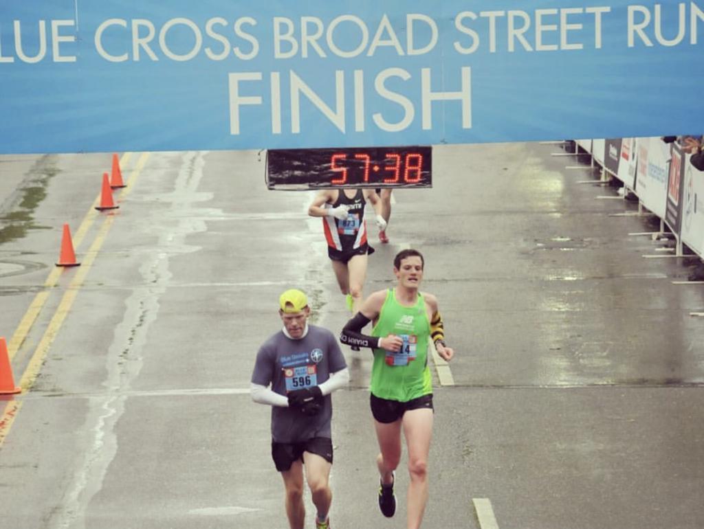 Colin Barrett crossing the finish line at the Blue Cross Broad Street Run