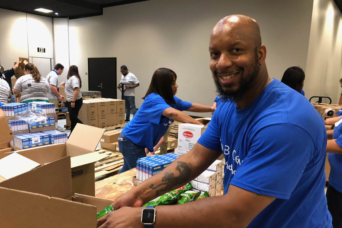 Michael Allen boxing up food at a volunteer event