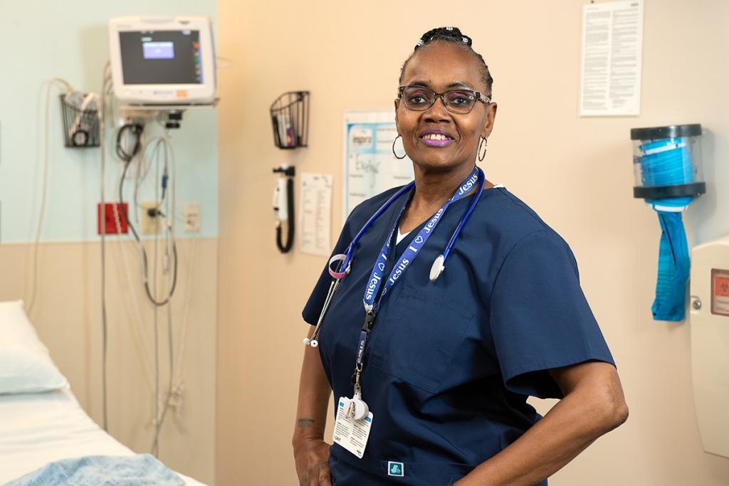 Nurse Evelyn Cannon-Dingle, in a hospital room