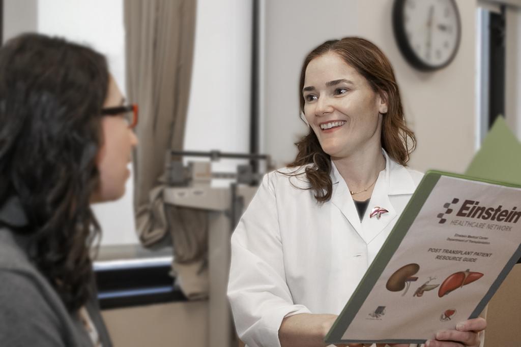 Nurse Megan Vennalil talks to another woman