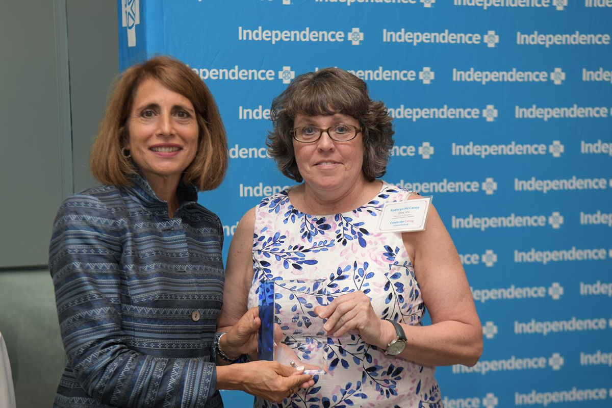 Paula Sunshine presenting Kathryn McCaney with an award