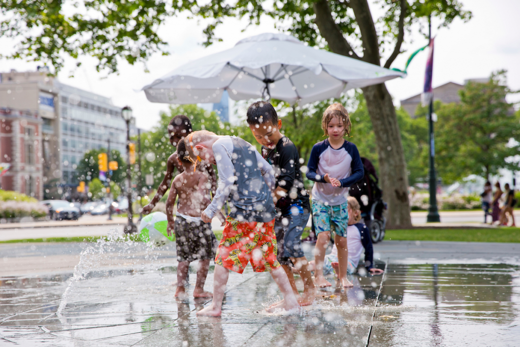 Children play in a fountain