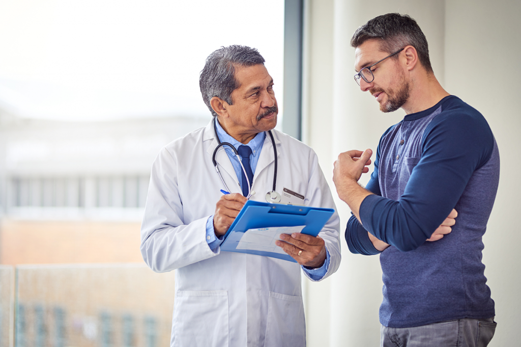 A man speaks with a doctor