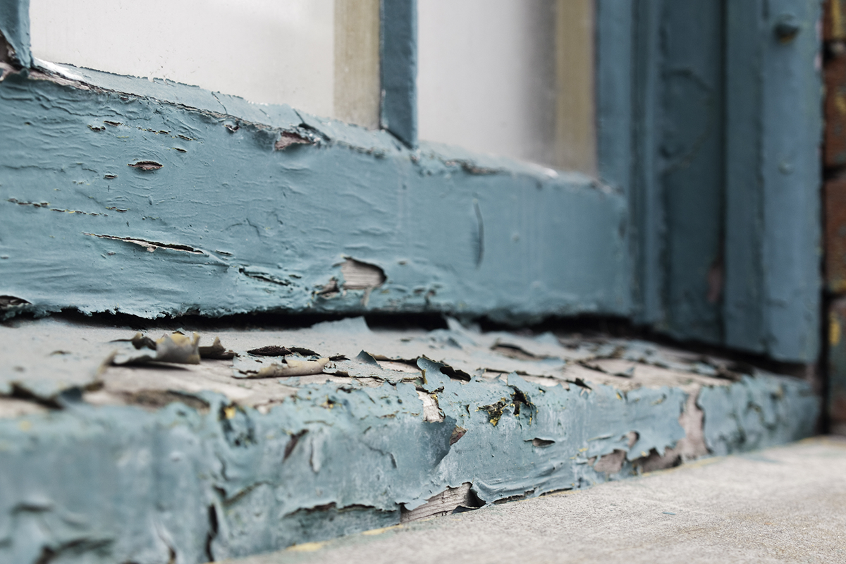Paint peeling on an old windowsill