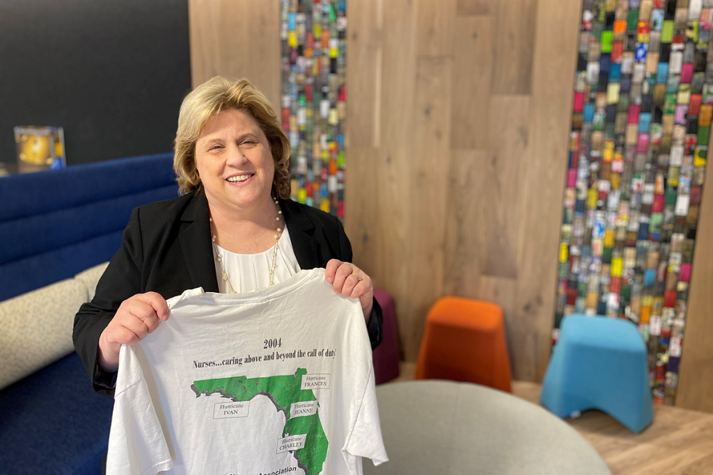 Linda Bolmer, holding a t-shirt and smiling