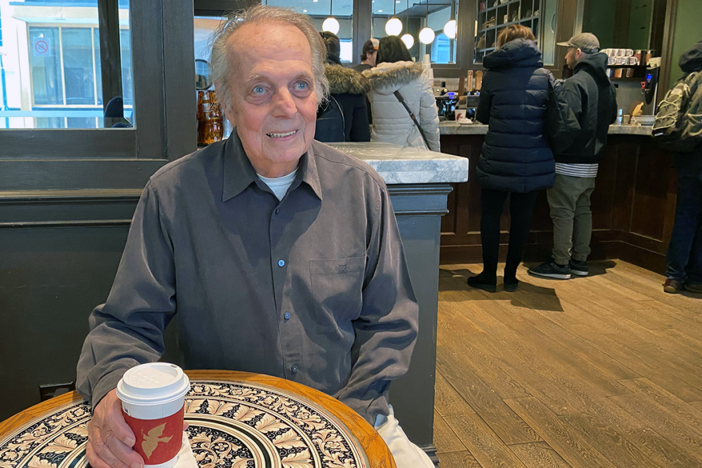 Member Rich Croll, sitting in a cafe
