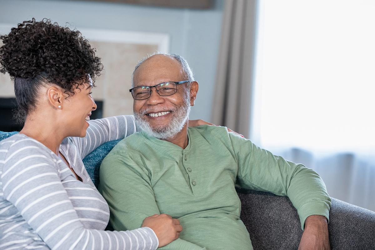 Adult daughter visits senior father
