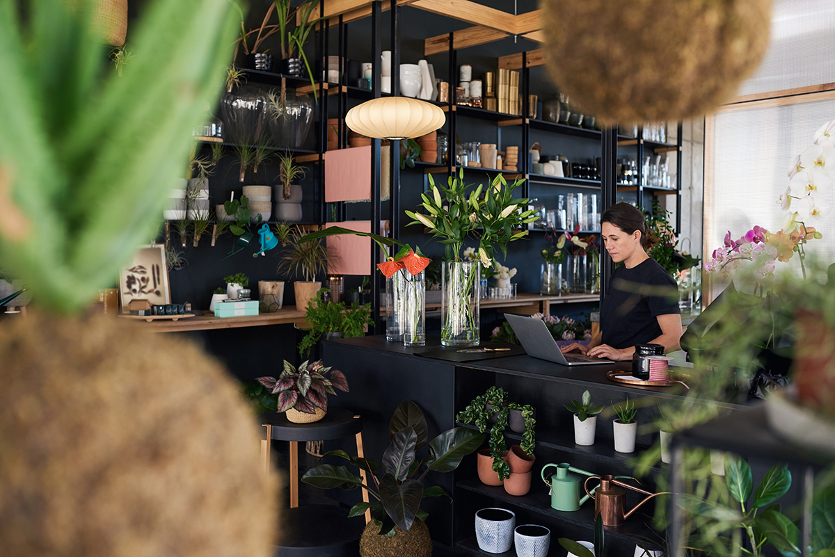 Florist working on a laptop in her flower shop