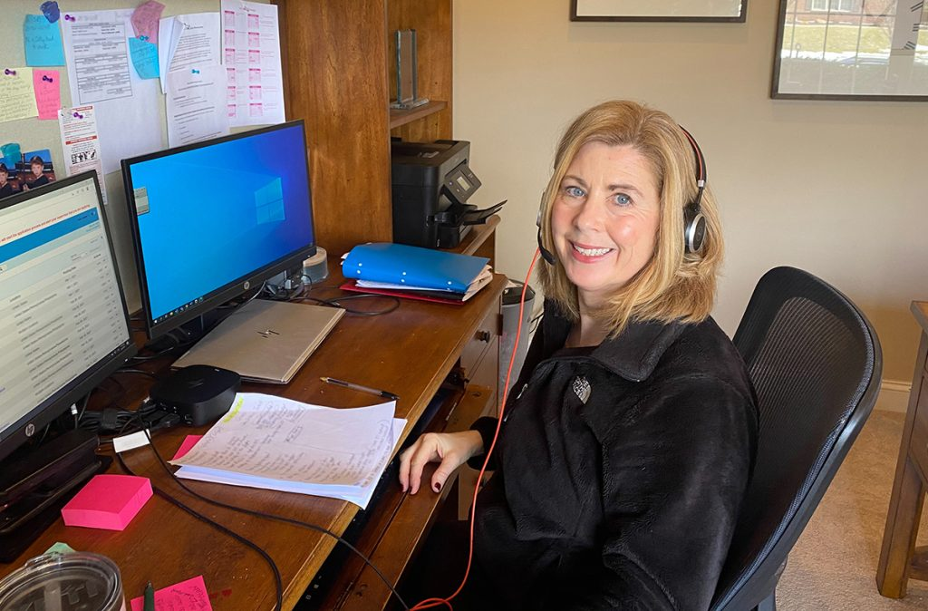 Registered Nurse Health Coach Lisa Lokuta working out of her home office.