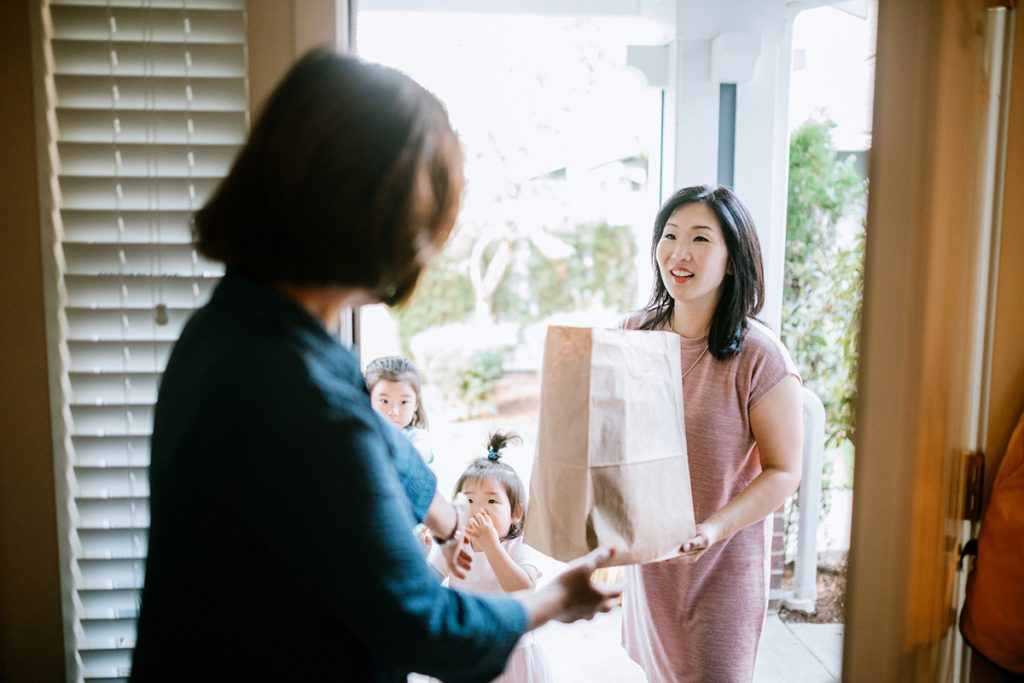 Woman Delivers Groceries to Her Mother