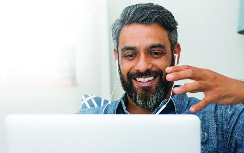 Man using laptop for video call