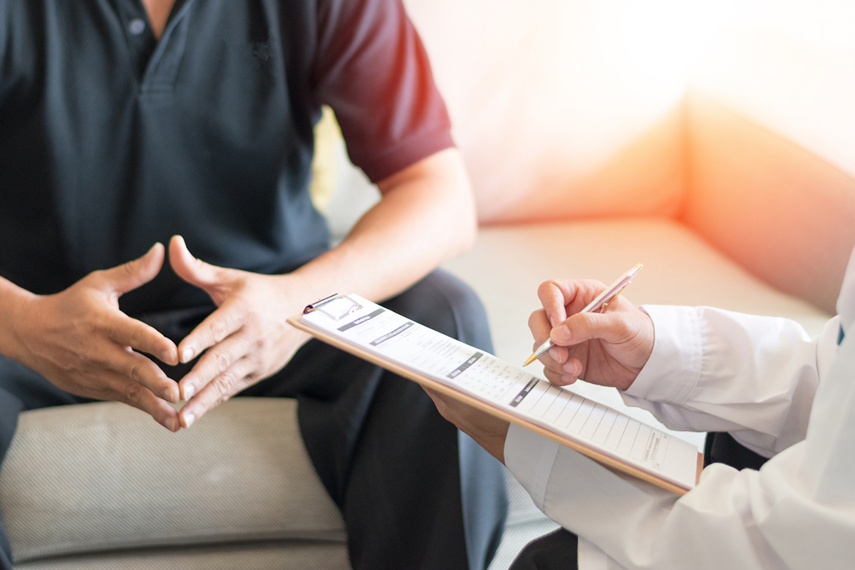 Urologist giving consult for prostate problems to patient.